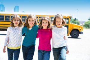 girls in front of school bus